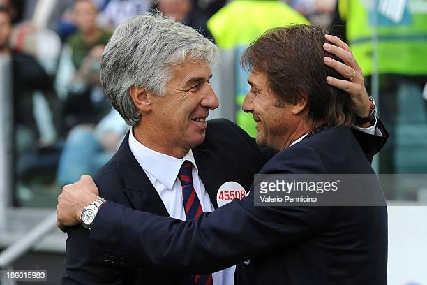 Head coach Gian Piero Gasperini of Genoa CFC greets head coach Antonio Conte of Juventus prior to the Serie A match between Juventus and Genoa CFC at...