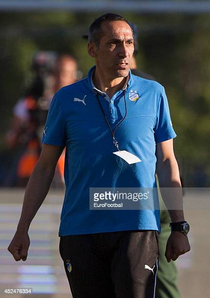Head Coach Giorgos Donis looks on during the Cypriot First Division match AEL Limassol FC and APOEL FC at the Tsirion Stadium on May 17 2014 in in...