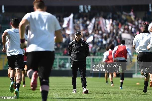 Head Coach Giuseppe Iachini watches his players in action during a Palermo training session at Renzo Barbera Stadium on April 28 2014 in Palermo Italy
