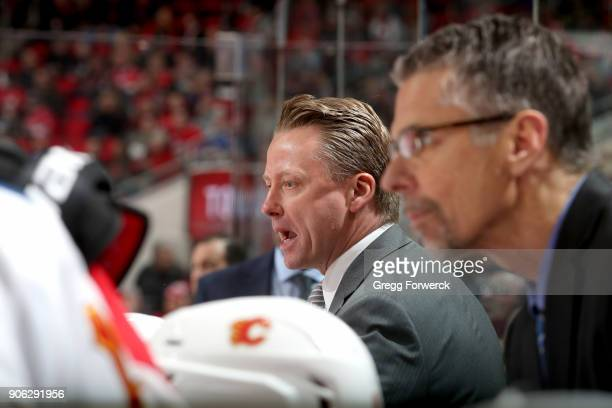 Head coach Glen Gulutzan of the Calgary Flames argues a call on the ice during an NHL game against the Carolina Hurricanes on January 14 2018 at PNC...