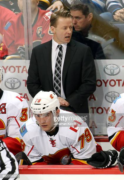 Head Coach Glen Gulutzan of the Calgary Flames calls out instructions from the bench during first period action against the Winnipeg Jets at the MTS...