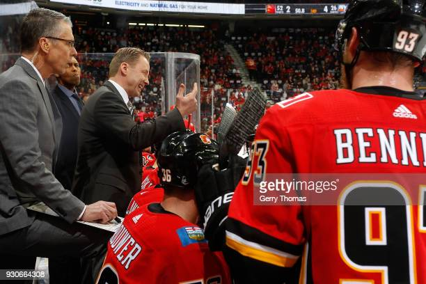 Head coach Glen Gulutzan of the Calgary Flames gives instructions to the team during an NHL game against the New York Islanders on March 11 2018 at...