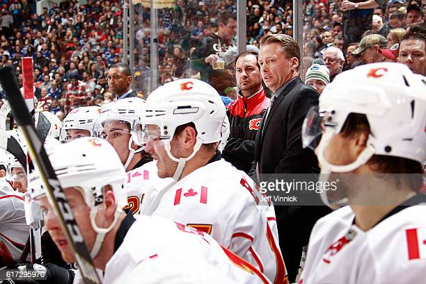 Head coach Glen Gulutzan of the Calgary Flames looks on from the bench during their NHL game against the Vancouver Canucks at Rogers Arena October 15...