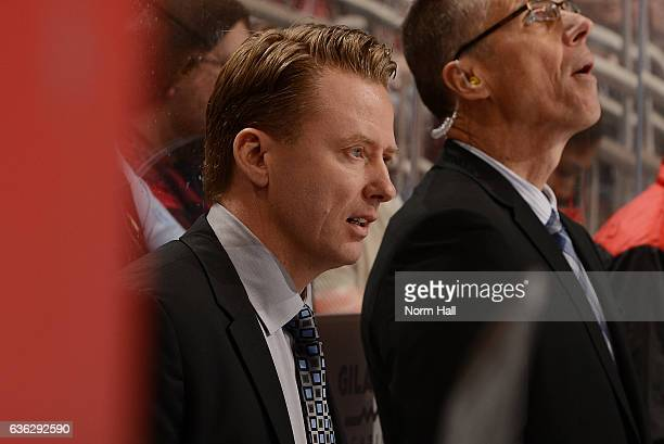 Head coach Glen Gulutzan of the Calgary Flames looks on from the bench against the Arizona Coyotes at Gila River Arena on December 19 2016 in...