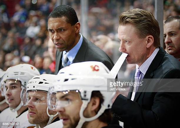 Head coach Glen Gulutzan of the Calgary Flames looks on from the bench during their NHL game against the Vancouver Canucks at Rogers Arena January 6...