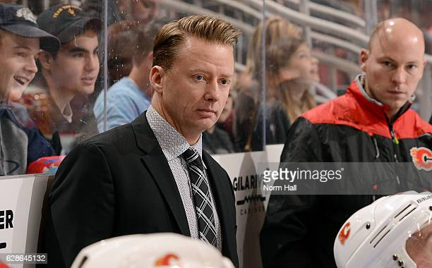 Head coach Glen Gulutzan of the Calgary Flames watches first period action against the Arizona Coyotes at Gila River Arena on December 8 2016 in...