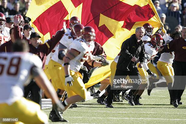 Head coach Glen Mason of Minnesota rushes on the field with his team as the last seconds tick away against Michigan on October 8 2005 at Michigan...