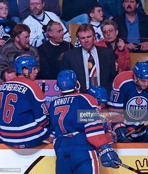 Head coach Glen Sather and Jason Arnott of the Edmonton Oilers have a chat against the Toronto Maple Leafs during NHL game action on February 19,...