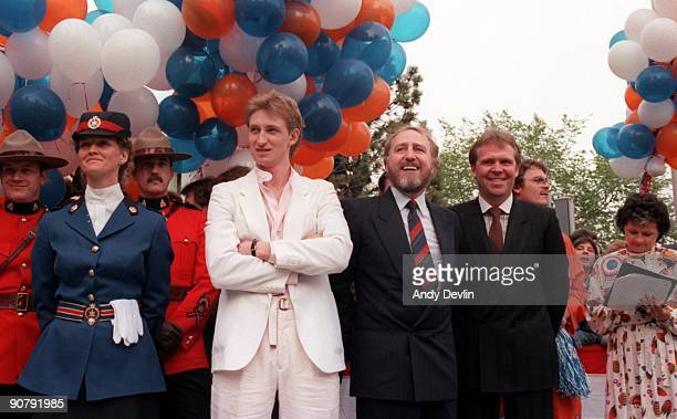 Head Coach Glen Sather owner Peter Pocklington and Wayne Gretzky of the Edmonton Oilers look on during a parade to celebrate their Stanley Cup...