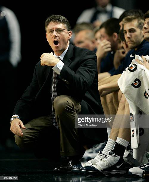 Head coach Glenn Miller of the Penn Quakers shout at an official during the first half of their game against the Penn State Nittany Lions at the...