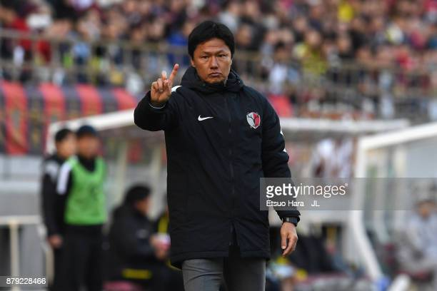 Head coach Go Oiwa of Kashima Antlers gestures during the JLeague J1 match between Kashima Antlers and Kashiwa Reysol at Kashima Soccer Stadium on...