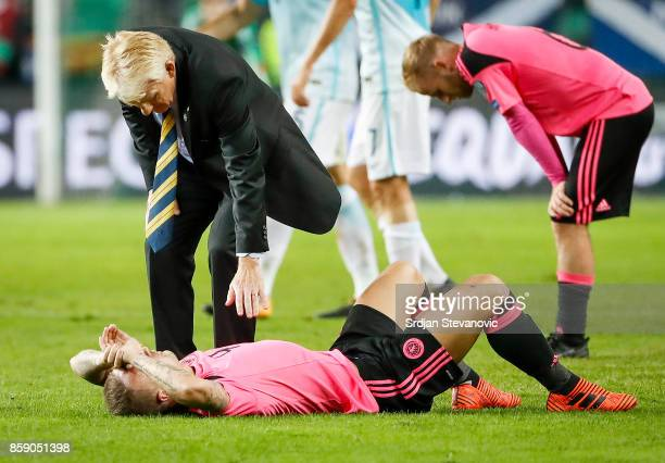 Head coach Gordon Strachan comforts Leigh Griffiths of Scotland after the FIFA 2018 World Cup Qualifier match between Slovenia and Scotland at...