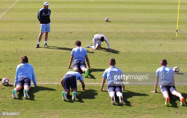 Head coach Graham Arnold looks on during a Sydney FC ALeague training session at Macquarie Uni on May 6 2017 in Sydney Australia