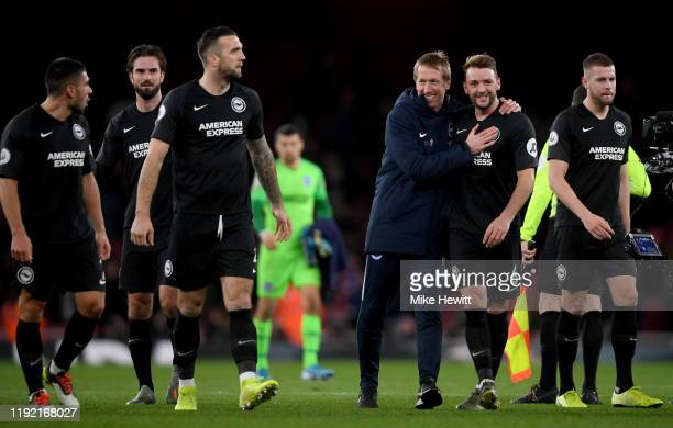 Head coach Graham Potter of Brighton celebrates with Dale Stephens of Brighton after winning the Premier League match between Arsenal FC and Brighton...