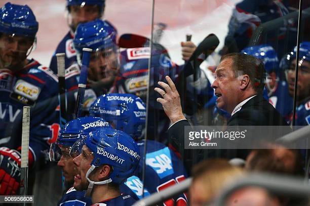 Head coach Greg Ireland of Mannheim talks to the players during the DEL match between Adler Mannheim and Straubing Tigers at SAP Arena on January 26...