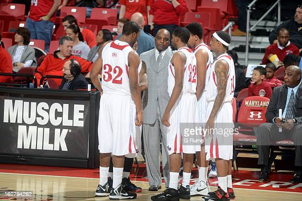 Head coach Greg Jackson of the Delaware State Hornets talks to his team during the game against the Maryland Terrapins at the Comcast Center on...
