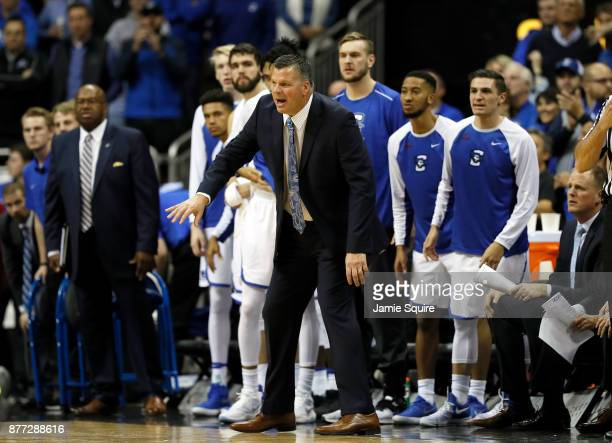 Head coach Greg McDermott of the Creighton Bluejays coaches from the bench during the National Collegiate Basketball Hall Of Fame Classic...