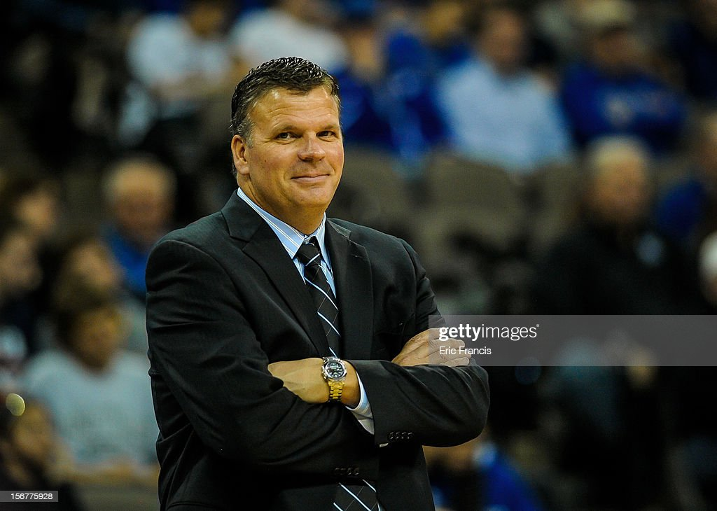 Head coach Greg McDermott of the Creighton Bluejays smiles as his team handily defeats Longwood Lancers during their game at CenturyLink Center on November 20, 2012 in Omaha, Nebraska.