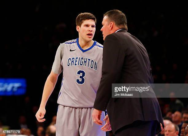 Head coach Greg McDermott talks to his son Doug McDermott of the Creighton Bluejays in the first half against the Providence Friars during the...