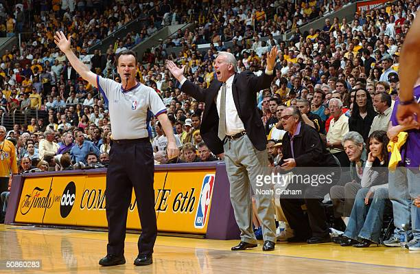 Head coach Greg Popovich of the San Antonio Spurs argues while referee Mike Callahan raises a hand in Game six of the Westen Conference Semifinals...
