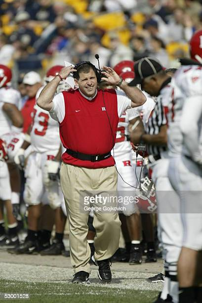 Head coach Greg Schiano of the Rutgers University Scarlet Knights approaches an official during a game against the University of Pittsburgh Panthers...