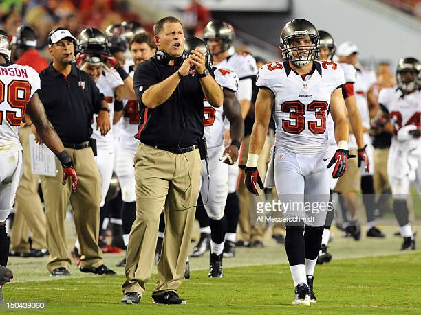Head coach Greg Schiano of the Tampa Bay Buccaneers cheers play against the Tennessee Titans in an NFL preseason game August 17 2012 at Raymond James...