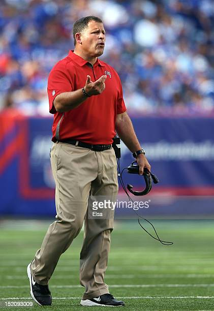 Head coach Greg Schiano of the Tampa Bay Buccaneers directs his players in the fourth quarter against the New York Giants on September 16 2012 at...