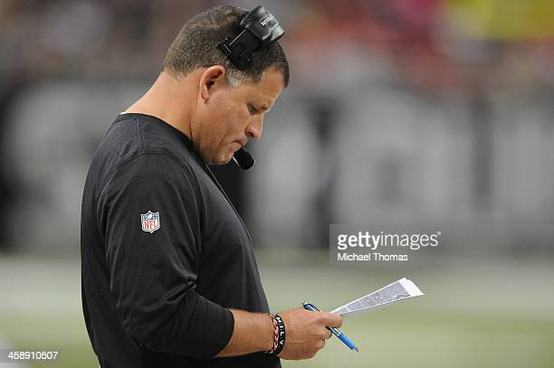 Head coach Greg Schiano of the Tampa Bay Buccaneers looks at plays from the sidelines during a game against the St Louis Rams at the Edward Jones...