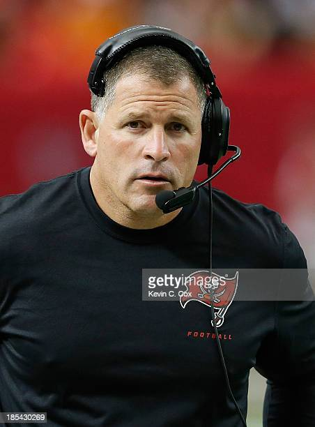 Head coach Greg Schiano of the Tampa Bay Buccaneers looks on prior to the game against the Atlanta Falcons at Georgia Dome on October 20 2013 in...
