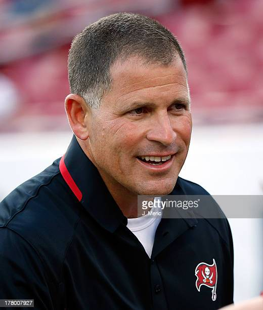 Head coach Greg Schiano of the Tampa Bay Buccaneers talks with some fans just before the start of the preseason game against the Baltimore Ravens at...