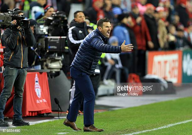 Head coach Greg Vanney of Toronto FC shouts to his players during the second half of an MLS Conference semifinal playoff game against New York City...