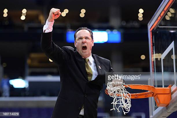 Head coach Gregg Marshall of the Wichita State Shockers celebrates by cutting down the net after defeating the Ohio State Buckeyes 7066 during the...