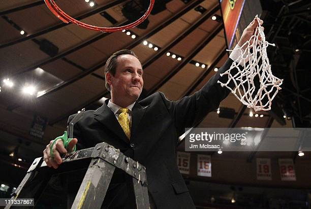 Head coach Gregg Marshall of the Wichita State Shockers celebrates after defeating the Alabama Crimson Tide to win the 2011 NIT Championship game on...