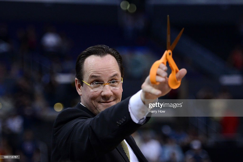 Head coach Gregg Marshall of the Wichita State Shockers holds up a pair of scissors before cutting down the net after defeating the Ohio State Buckeyes 70-66 during the West Regional Final of the 2013 NCAA Men's Basketball Tournament at Staples Center on March 30, 2013 in Los Angeles, California.