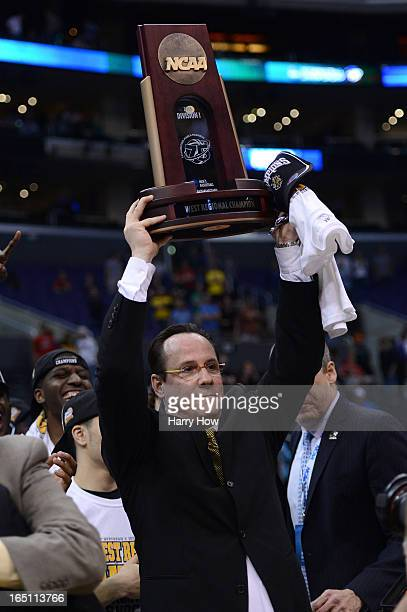 Head coach Gregg Marshall of the Wichita State Shockers holds up the West Regional Trophy after defeating the Ohio State Buckeyes 7066 during the...