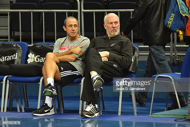 Head Coach Gregg Popovich and Assistant Coach Ettore Messina of the San Antonio Spurs talk prior to a game against Fenerbahce Ulker as part of the...
