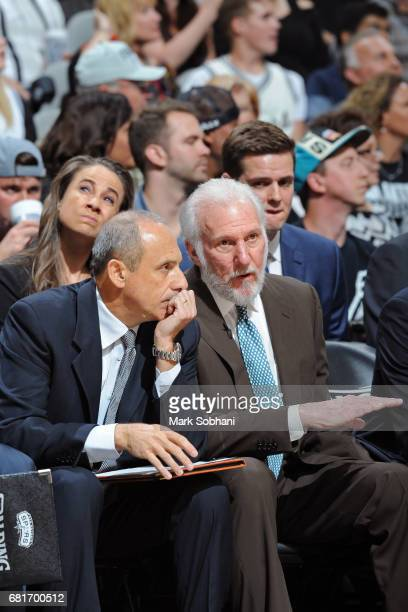 Head Coach Gregg Popovich and Ettore Messina of the San Antonio Spurs talk on the bench in Game Five of the Western Conference Semifinals on May 9,...