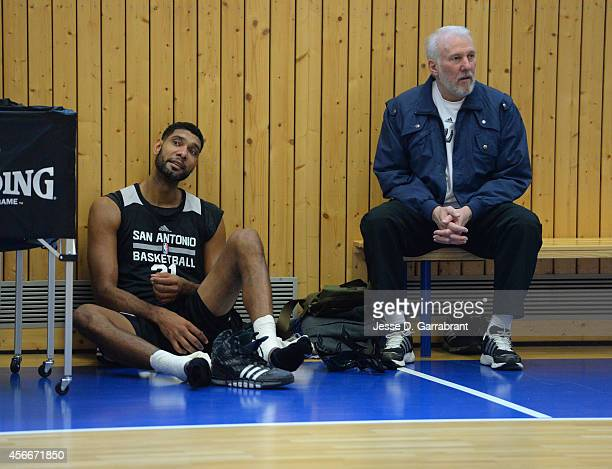 Head Coach Gregg Popovich and Tim Duncan of the San Antonio Spurs talk during practice as part of the 2014 Global Games on October 5 2014 at the Alba...