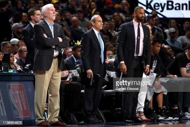 Head Coach Gregg Popovich, Assistant Coach Ettore Messina, and Assistant Coach Ime Udoka of the San Antonio Spurs look on during Game One of Round...
