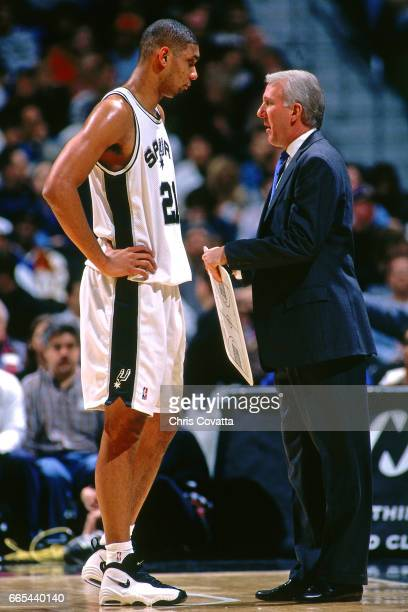 Head Coach Gregg Popovich chats with Tim Duncan of the San Antonio Spurs against the Vancouver Grizzlies on December 17 1997 at the Alamodome in San...