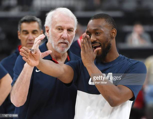 Head coach Gregg Popovich of the 2019 USA Men's National Team talks with Kemba Walker of the 2019 USA Men's National Team before the 2019 USA...