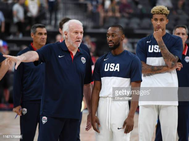 Head coach Gregg Popovich of the 2019 USA Men's National Team talks with Kemba Walker of the 2019 USA Men's National Team as Kyle Kuzma of the 2019...