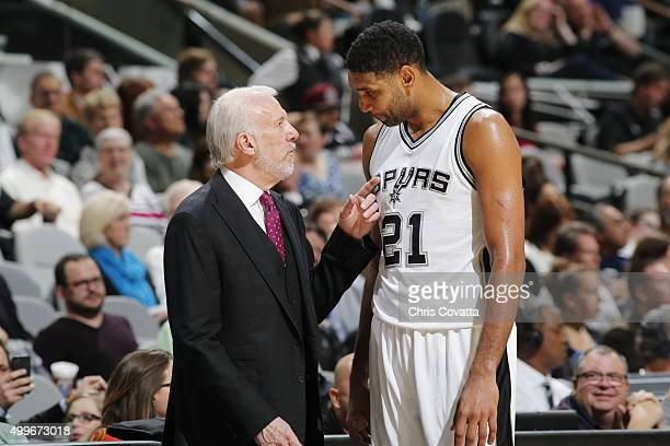 Head coach Gregg Popovich of the San Antonio Spurs and Tim Duncan of the San Antonio Spurs talk during the game against the Milwaukee Bucks on...
