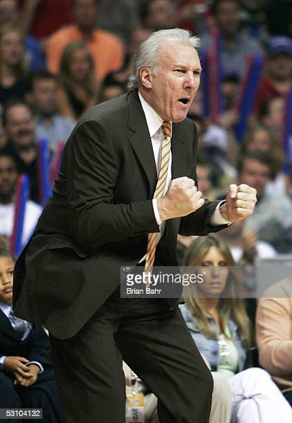Head coach Gregg Popovich of the San Antonio Spurs communicates from the sidelines in the second quarter while taking on the Detroit Pistons in Game...