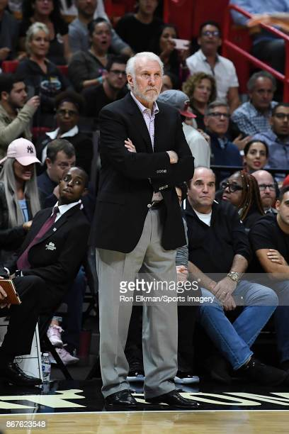 Head coach Gregg Popovich of the San Antonio Spurs reacts during a NBA game against the Miami Heat at American Airlines Arena on October 25 2017 in...