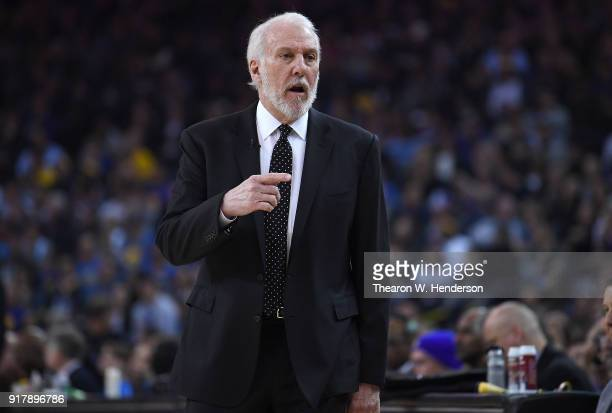 Head coach Gregg Popovich of the San Antonio Spurs reacts to his teams play on the court against the Golden State Warriors during an NBA basketball...