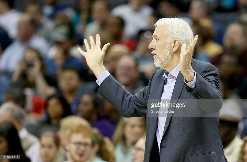 Head coach Gregg Popovich of the San Antonio Spurs reacts to his team against the Charlotte Hornets during their game at Time Warner Cable Arena on March 21, 2016 in Charlotte, North Carolina.NOTE