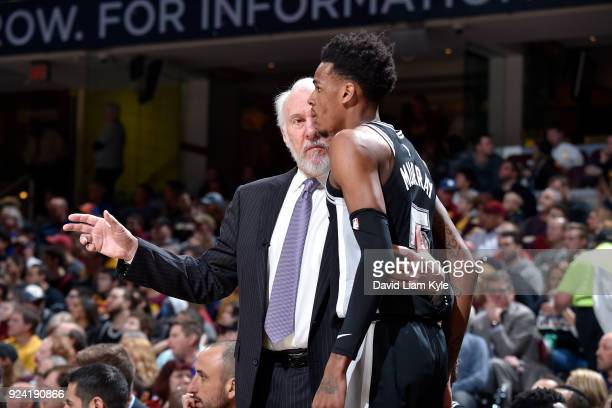 Head Coach Gregg Popovich of the San Antonio Spurs speaks to Dejounte Murray of the San Antonio Spurs during the game against the Cleveland Cavaliers...