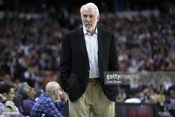 Head coach Gregg Popovich of the San Antonio Spurs stands on the court during their game against the Sacramento Kings at Sleep Train Arena on...