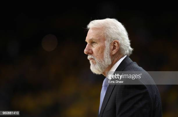 Head coach Gregg Popovich of the San Antonio Spurs stands on the side of the court during their game against the Golden State Warriors during Game 2...